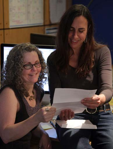 Dorothy and Christine looking excitedly at their Bell Fund acceptance letter