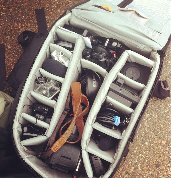 Knapsack with assorted camera gear