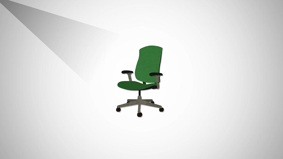 An animated green chair sits in the middle of a white space.