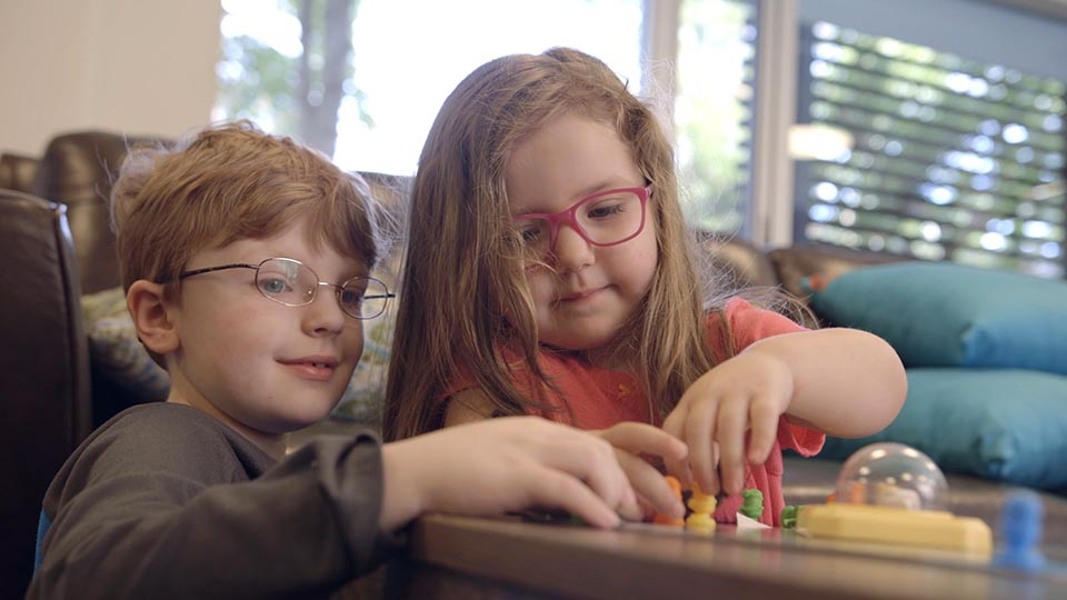 Two young kids from the Ronald McDonald House play